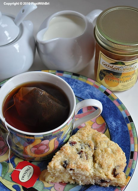 cup of orange pekoe tea, cranberry citrus scone, meyer lemon marmalade