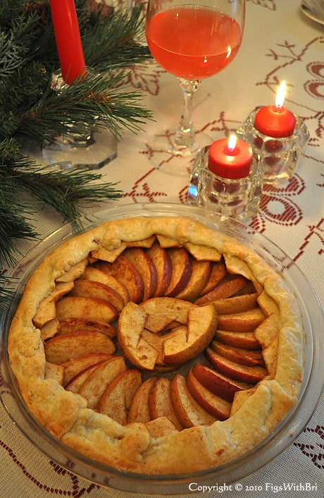 photo of rustic apple tart on christmas dinner table