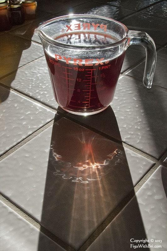 black rice dark soaking water in pyrex cup